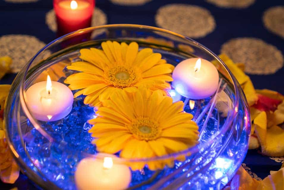 low centerpieces with yellow marigoldflowers at baar baar restaurant