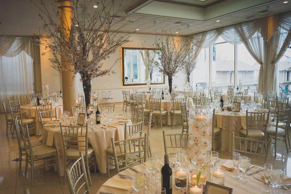 cherry blossom reception stage decor at greentree country club