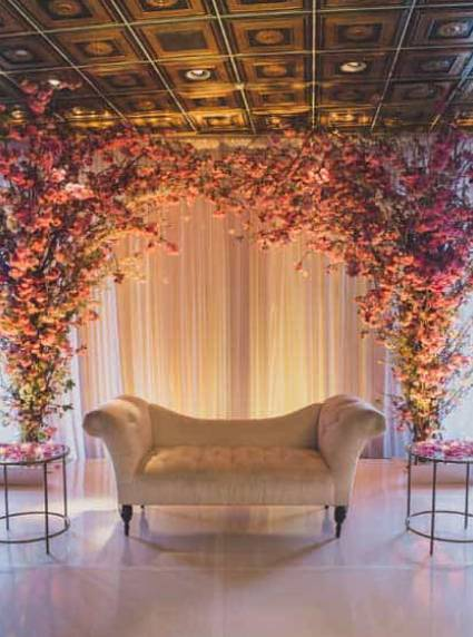 cherry blossom reception stage decor at vip country club